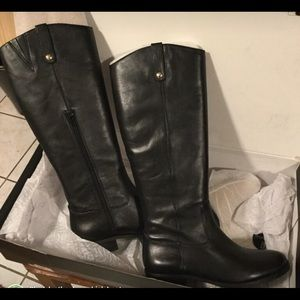 Black leather knee- high boots